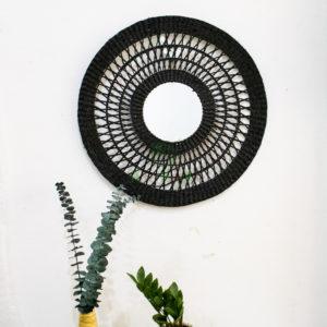 Black round open weave seagrass mirror for wall decor